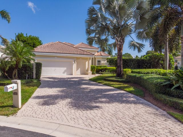 Updated and well maintained 3 bedroom, 3 bath home located on a private cul-de-sac in the prestigious Loxahatchee Club in Jupiter.  This welcoming, light and bright home features high ceilings with floor to ceiling windows to enjoy the serene lake views from all living areas.  There are hardwood floors throughout the spacious living room, dining room, great room and kitchen.  The updated kitchen is the heart of the home with custom cabinetry, reaches of granite countertops, sparkling stainless appliances and is open to the family room and breakfast room.  The large master suite offers the owners a comfortable retreat with a renovated spa like master bath and oversized shower and two walk in closest.  Two additional guest suites are perfect for visiting friends and family. A private office is sun drenched and offers access to the outdoors.  Enjoy the utmost in Florida living from your oversized covered lanai with beautifully detailed plank ceiling.  Outdoors you will find a vanishing edge spa, limestone patios and picture perfect, tranquil, panoramic views.  A pavered driveway to garages for two cars plus separate golf cart garage completes this perfect home.