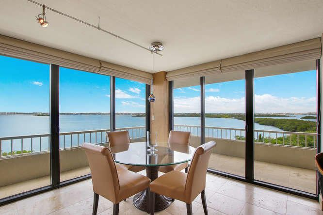 Gorgeous private panoramic views of the Intracoastal Waterway, MacArthur State Park, and the Ocean from this updated corner condo. The flooring is a beautiful 24 inch travertine throughout the entire unit and both bedrooms have glass French doors opening into the great room to enhance the views everywhere. The kitchen is completely opened with a large round eat in bar at the end and offers granite counter tops, tile backsplash and custom wood and glass cabinetry plus a stainless steel appliance package. The bathrooms were renovated with marble designed tile walls, granite tops and frameless glass shower door in the master. Being offered furnished with parking space  640. Residents enjoy a number of amenities including 1,025 feet of private beach frontage, two heated pools, four tennis courts and beautiful recreation deck with a brand new owner's lounge built in 2014 offering beautiful ocean views. Each building has its own exercise room, library and extra storage. Water Glades is accessed by a 24 hour manned gate and is adjacent to MacArthur Beach State Park with 438 acres of natural Florida beach, islands and nature preserve.