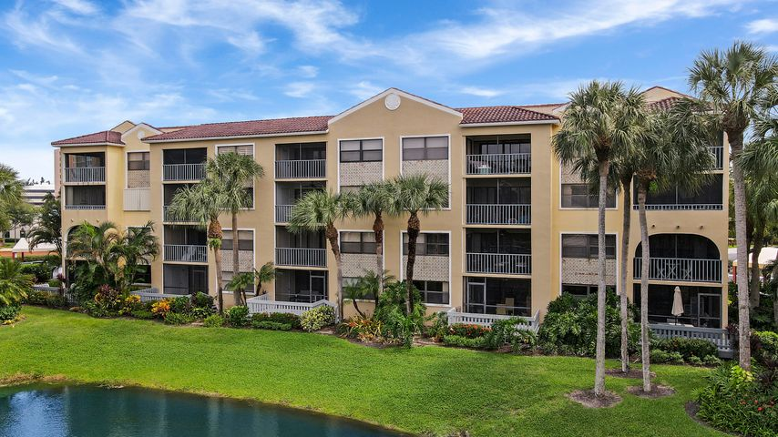 Cute 2 bedroom/2 bath condo in popular gated community of Ocean Trace, Juno Beach! Located on the 2nd floor, there is a screened-in balcony overlooking the serene lake with a soothing water fountain. Granite kitchen with Stainless Steel appliances. Master bedroom has walk-in closet. This condo would be a great investment property or second home in sunny Florida. Property amenities include two pools, hot tub, clubhouse, business center and a fitness center. Excellent location- Close to beaches, shopping, & restaurants!