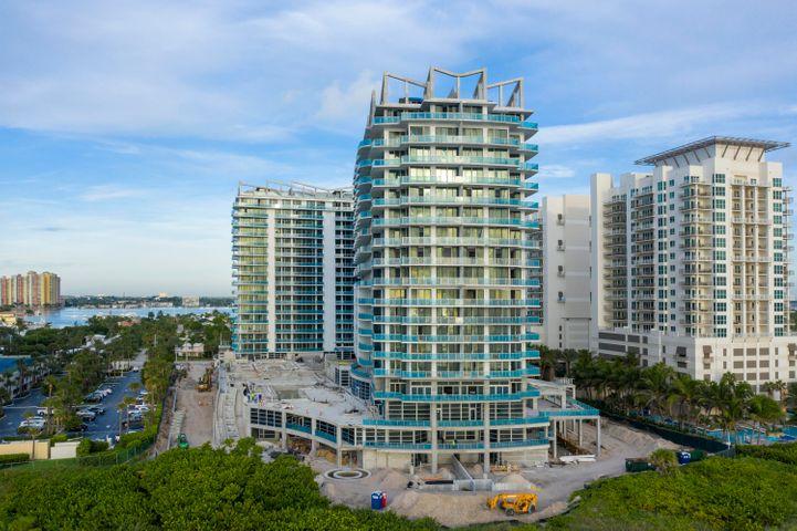 Say hello to penthouse-style ocean & pool views & 2,200 square feet of modern open-concept living offered with Unit 1904. This newly constructed Amrit residence also offers a sleek kitchen complete with European cabinetry, quartz countertops, & Wolf appliances, imported porcelain tile flooring throughout, a den/study, spacious walk-in closets, & floor-to-ceiling hurricane impact windows, & a 300 square foot private terrace overlooking the ocean & pool. Indulge in the luxurious Palm Beach lifestyle, as Amrit is just minutes from prestigious Worth Avenue shopping (think CHANEL & Louis Vuitton), exquisite 5-star restaurants, reputable golf-courses including Seminole Golf Club & Lost Tree Club, Peanut Island, & Palm Beach International Airport. In addition, the ocean & intracoastal surrounding your residence happens to offer one of the best locations in the country for snorkeling, surfing, & paddle-boarding.  Experience an exclusive dining experience at Amrit's ocean-front restaurant, which is one of only two ocean-front restaurants in Palm Beach. Unit 1904 is located high-up within the Peace Tower, which is strictly residential & thus offers resident-only amenities. Amrit's emphasis is on Health & Wellness, which is made obvious through the plethora of on-theme amenities offered. These amenities include a fitness center, Pilates studio, Wellness Spa with twenty-two treatment rooms, a yoga terrace, meditation garden, social terrace with a BBQ area, a heated pool, and attended pool-side & oceanfront cabanas. In addition to these, Amrit offers 27/4 security & lobby attendants, a complimentary valet, and electric-car charging stations. Amrit Ocean Resort is truly spectacular & you must come see it for yourself!