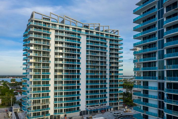 Unit 1404 surely doesn't disappoint with its direct ocean & pool views on a private terrace, astounding 2,200 square feet of open-concept living, & private valet service! This newly constructed Amrit residence also offers a sleek kitchen complete with European cabinetry, quartz countertops, & Wolf appliances, imported porcelain tile flooring throughout, a den/study, spacious walk-in closets, floor-to-ceiling hurricane impact windows. Indulge in the luxurious Palm Beach lifestyle, as Amrit is just minutes from prestigious Worth Avenue shopping (think CHANEL & Louis Vuitton), exquisite 5-star restaurants, reputable golf-courses including Seminole Golf Club & Lost Tree Club, Peanut Island, & Palm Beach International Airport. In addition, the ocean & intracoastal surrounding your residence happens to offer one of the best locations in the country for snorkeling, surfing, & paddle-boarding.  Experience an exclusive dining experience at Amrit's ocean-front restaurant, which is one of only two ocean-front restaurants in Palm Beach. Unit 1404 is located within the Peace Tower, which is strictly residential & thus offers resident-only amenities. Amrit's emphasis is on Health & Wellness, which is made obvious through the plethora of on-theme amenities offered. These amenities include a fitness center, Pilates studio, Wellness Spa with twenty-two treatment rooms, a yoga terrace, meditation garden, social terrace with a BBQ area, a heated pool, and attended pool-side & oceanfront cabanas. In addition to these, Amrit offers 27/4 security & lobby attendants, a complimentary valet, and electric-car charging stations. This Amrit Ocean Resort residence is truly remarkable & you must come see it for yourself!