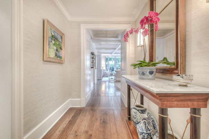 A rare 3-bedroom unit in a boutique building, One Royal Palm.  On Palm Beach's desirable in-town street, this units location is moments from hotels, restaurants, the beach and shops including the iconic Worth Avenue. This 2,123square foot condo unit has gone under a complete renovation including Calcutta counters, solid hardwood flooring and intricate millwork.