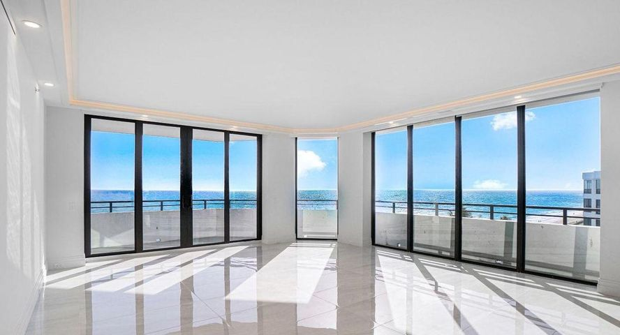 This rare SE corner Penthouse is currently the largest available condo for sale on all of Palm Beach Island! Located in the South Tower at The Palm Beach Hampton, the preeminent oceanfront, full-service condominium, PH 605S has just completed a 2.5 year, multi-million dollar renovation. This newly envisioned 'Beach Home in the Sky' designed by Ames International Architecture and Louis Anthony & Associates features 5 bedrooms, 4 full bathrooms + two 1/2 bathrooms.  Some of the features of this stunning Penthouse are soaring ceilings, newly installed floor to ceiling impact glass windows, beautiful chefs' modern kitchen with Wolf & Subzero appliances, and two master suites with enormous bathrooms and closets. Enjoy direct ocean and intracoastal views from every room or from the massive wrap round balcony. Included in the sale of PH 605S is a prime poolside cabana & two side by side premium parking spaces in the building's garage. Palm Beach Hampton has undergone a several year total renovations to all common areas, including concrete restoration, stylish interior design and two gorgeous new lobbies. The pool deck features two spas, BBQ area & poolside cabanas with beach access. There is a 24H security gate, attended lobbies, state of the art gym, club rooms, tennis, and glass elevators overlooking the landscaped courtyard & building waterfalls. Palm Beach Hampton is pet friendly. Seasonal pool/ beach attendant. All assessments are paid in full!