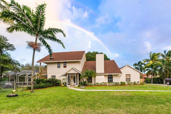 Move right into this Beautiful Key West Style home right here in Lake Worth with NO HOA! This 3 bed, 2 bath home with a pool is nestled at the end of the culdesac surrounded by water views and canal access to Lake Osborne. Entertaining made easy on this huge lot. Cook out in the enclosed patio or enjoy endless days of swimming in the heated pool all year round. Roof replaced in 2018. Two zone Central Air Unit , Impact Windows & more. Close to the beach, downtown Lake Worth, dining & entertainment. Don't miss out!