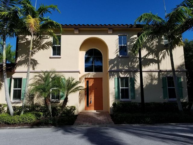 Wonderful sought after Large 4 bedrooms, 3.5 baths, 2 car garage in Palm Beach Gardens.  There are only a handful of this type unit in the community and they don't come on the market often. Great home for a family with many upgrades that include Crown Molding downstairs that also includes a lovely bedroom and full bath that could be a Master suite. there is a powder room on the 1st level as well. Upgraded kitchen with Granite, Stainless Steel appliances that opens to the Great Room and Dining Area.  Master Bedroom has Hardwood floors and Custom closet system. There are two additional bedrooms on the upper level with full bath and Laundry Room for convenience. there is a nice size loft great for an office. Home has hurricane impact glass windows. The private back yard for grilling and enjoy