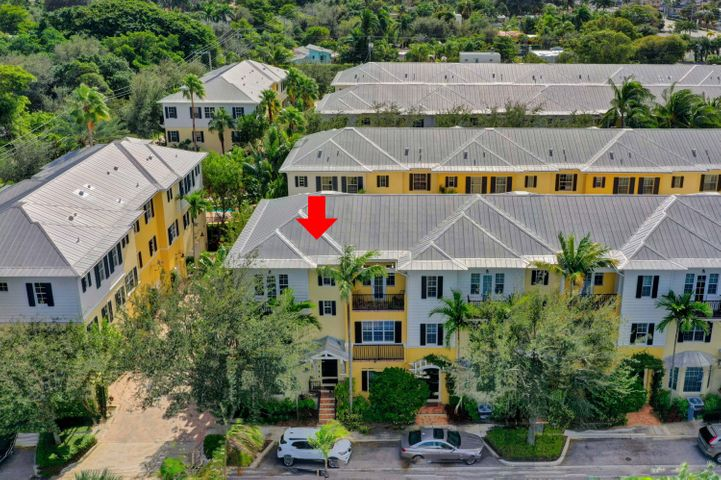 Magnolia Court is a luxury townhome community in downtown West Palm Beach.  It is one block to the Intracoastal Waterway, surrounded by historic communities and close to shopping/restaurants. This 3BR/3.5BA three story townhome has a bedroom, full bath and laundry on the first floor.  The second level has the open kitchen floor plan w/large dining area, living room and powder room. On this level, there are wood floors, crown moldings and a bar area. The kitchen has solid wooden cabinets, stainless steel appliances and backsplash, granite countertops and a large pantry. The third floor has two bedrooms with en suite baths. The Primary Bedroom features a 14-foot vaulted ceiling, Juliette balcony, separate shower/water closet, dual vanity, spa tub and huge closet. You will love the location. The townhome includes a metal roof, lots of storage, hurricane impact windows and a two car garage. The garage has a pebble tech floor, long row of storage cabinets, small workshop area and central vacuum. You will enjoy community amenities like the swimming pool, gas grill area, men's/women's facilities and relaxing courtyard with fountains and benches.