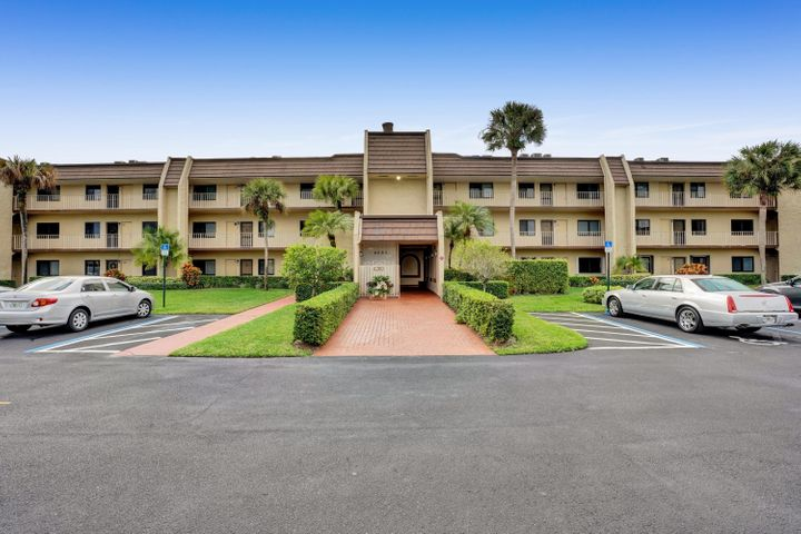 Beautiful, peaceful all ages condo at the Fountains of Palm Beach, with no mandatory membership fees.3 bedrooms, 2 bathrooms. One of the bedrooms can be converted to a living space with a sliding door. This fully updated unit is move in ready. Featuring white porcelain tile floors, white shaker kitchen cabinets and granite countertops, this home is bright and has an open feel. This second floor unit is accessible via elevator and has an additional storage space on the first floor. It is an easy walk to the pool just feet from  building. The Fountains of Palm Beach, has a 24 hour manned gate, clubhouse, restaurant, golf course ,pool, tennis courts. Maintenance fee includes cable, common areas lawn care, pool service, trash removal, exterior maintenance, pest control, roof maintenance.