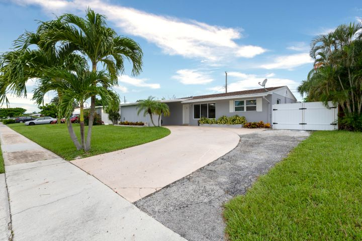 Beautifully Updated CBS 3BD/ Plus Den/Office 2BA single story home with carport centrally located in Palm Beach Gardens.Enjoy florida living in your large fenced in backyard complete with  pool/Spa and oversized screened in patio.Features of this light and bright home include an open split floor plan,large diagonal tile flooring,updated baths,upgraded 200 amp GE electric panel,LED hi hats.The kitchen offers custom cabinetry,stainless steel appliances and granite countertops.Home originally was a 4 bedroom which has been opened up to the main living area.The large Den/Office overlooks the pool and french doors lead to the screened in porch area. Beautiful well manicured street with No HOA.