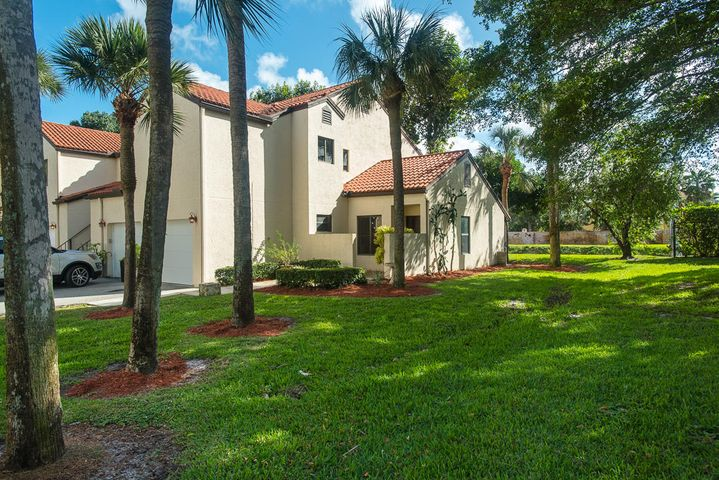 This rarely available 1st floor end unit with a garage in the very back of the gated community of Dos Lagos is the absolute best thing on the market in Boynton Beach for $225,000! Brand new floor luxury vinyl waterproof floors, brand new appliances, brand new custom cabinets with lazy susan and soft close doors, brand new Quartz countertops, and 2 new subway tiled bathrooms! 1 pet Allowed for owners. Investors welcome and for a limited time you can rent this out  instantly! Quickly write an offer before someone else does!