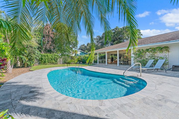 No Showings until Saturday 12/5! Remodeled home in Palm Point features a spacious open split floor plan with views from all living areas. Kitchen features an open floor plan, breakfast bar, eat-in kitchen, and plenty of cabinet space with storage. Additional features include: wood ceramic floors, remodeled bathroom, AC replaced in 2017, partial impact windows. The large outdoor living area has an oversized covered patio, fully fenced private landscaped spacious backyard, remodeled pool and pavers (2019) with plenty of room for additional storage and more. Palm Point is a waterfront community, enjoy a community dock to launch your kayaks and paddleboards just a short distance from your front door. Conveniently located in the heart of Jupiter near the beaches, restaurants, and top rated schools.