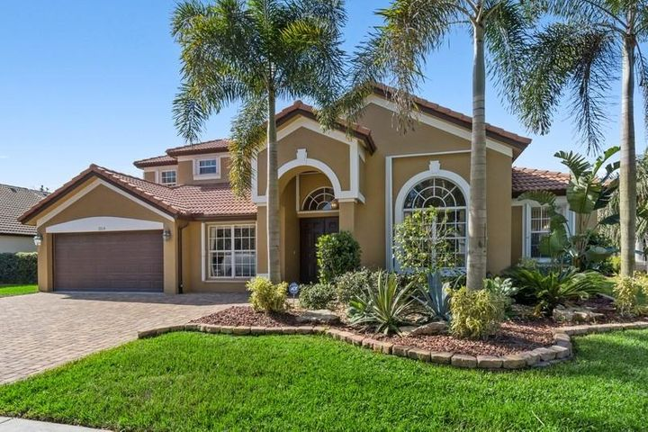 Looking for a large single family home with a HUGE lot, great outdoor patio in a GATED community with LOW HOA? Look no further! This WATERFRONT 6 bedroom 4 bathroom estate is located in Monterey Estates, a quiet, gated community.This stately home boasts all of the upgrades one could ever imagine! Open concept living, dining and kitchen area. New chef's grade kitchen with all the upgrades! Featuring Custom New Mahogany cabinetry with soft close, brushed nickel hardware, all NEW stainless steel appliances (fridge, beverage fridge, double ovens, dishwasher) Oversized Induction flat-top 5 burner electric range with pullout pot and pan drawers. New glass tile backsplash, new Quartz countertops, beverage fridge in the oversized island PLUS an oversized Stainless Steel German basin sink!  Enjoy every sunset from your outdoor sanctuary! Step outside into your heated, salt water swimming pool with a waterfall hot tub!  You'll never want to leave...and why would you!?  Too many upgrades to list. This home is an entertainer's dream and perfect for large families!  Monterey Estates is the best kept secret in all of Delray Beach! As an exclusive, boutique, gated community, with low HOA and NO EQUITY FEE! Situated less than 15 minutes to downtown Delray Beach and all Atlantic Avenue has to offer! Conveniently located just minutes to all major transportation, houses of worship, schools, shopping, 5 star dining and much more!  WILL NOT LAST!