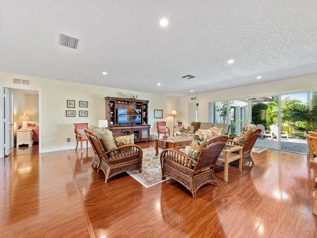 Motivated Seller! Make sure you bring your clients to this charming American ranch-style waterfront house with no fixed bridges, a 106 feet long seawall, and with its own boat dock. Located in the wonderful exclusive neighborhood of Fort Lauderdale known as The Landings, this 4,175 square foot, 4 bedrooms and 4 full bathrooms, house has a great location with a spectacular view from both the living room and kitchen. The kitchen features genuine wood cabinetry, granite counter tops, and has windows that open to conveniently serve as a bar area with outdoor seating. Outdoors you also have a separate alfresco dining area that's shaded by an overhang and equipped with a fully functional outdoor built-in BBQ grill with a ventilated hood. Lastly, you'll love the oversized master bedroom with an adjacent master bathroom, which center point is a very large and impressive walk-in shower covered with marble from the floor to the ceiling. And to top it off, you are within walking distance of the beach, and all the restaurants and other entertainment that is located next to the Pier in Lauderdale By the Sea.