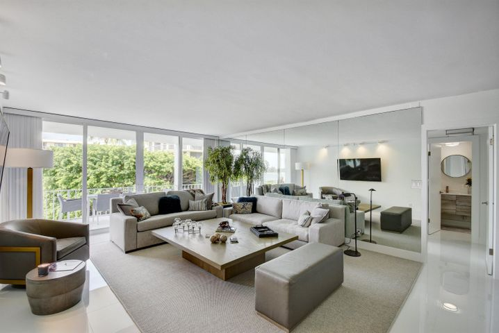 *MUST SEE* Experience waterfront boutique living in the desirable Cove Condominium. This completely renovated 2 bed-2 bath offers expansive one-of-a-kind views of the intracoastal, each bedroom has access to a 40 foot terrace. Tastefully decorated, with custom made pieces as well as Restoration Hardware furnishings. Impact  Hurricane glass sliders throughout. Also includes a fully renovated Cabana by the pool. 2 Assigned parking spots, and includes 3 storage units.  Amenities incl. fitness room, Doorman, Sauna, Club room, and more. Directly across from the newly renovated Four Seasons Hotel. Deeded beach access for The Cove residents Minutes away from Worth Avenue, Palm Beach airport, and the Palm Beach Par 3 Golf Course. Furnishings negotiable