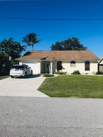 Lovely Key West style home located in the Heights of Jupiter.  Home is bright, open space with tile throughout the living areas and parque floors in two rooms.  Kitchen is open with granite counter top.  Bonus room that can be used as a TV room, play area or office.  Great schools near by and just a few minutes drive to Juno Beach.  Walking distance to Abacoa Down Town and close to Alton Center.  Heights of Jupiter is a very family friendly neighborhood.  Come and see!