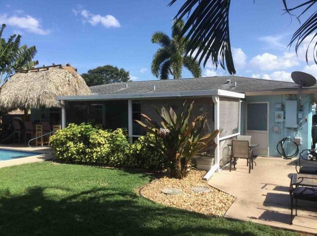 Beautifully updated pool home with a brand new kitchen and master bathroom. New hurricane impact windows. Outdoor living includes a newly resurfaced pool with a tiki bar and outdoor shower. Close to the Gardens Mall, Downtown Palm Beach Gardens and I-95.