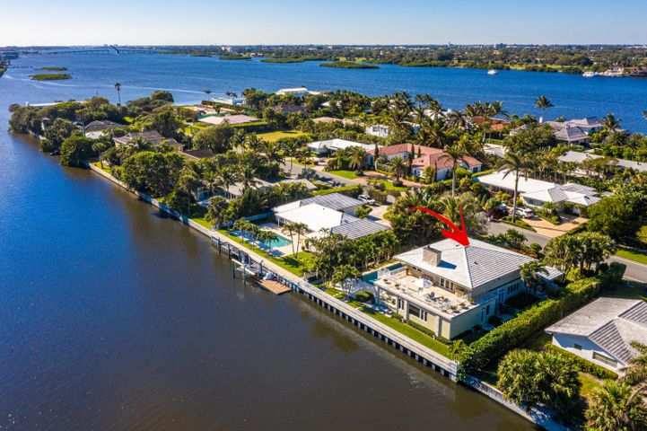 Beautiful totally renovated contemporary waterfront home on desirable Ibis Isle in Palm Beach. Large impact windows and doors lead out to the gardens and spacious pool area with a full summer kitchen and overlooking the east Intracoastal Waterway. Great for entertaining! A staircase from the terrace leads to a 2nd story waterfront deck. Watch the abundant bird life and boats go by while enjoying the breezes from the nearby Ocean. The home has an open floorplan with marble floors, coquina columns, and fireplace. Other features include a chefs kitchen with a gas stove, stylish baths, ample closets, large family room on the 1st level, and an office off the master bedroom. The home also offers a whole house water filtration system, state of the art generator, two car garage, and private entry. The island of Ibis Isle is extremely well located across A1A from Phipps Ocean Park, Palm Beach Tennis Center, and Palm Beach Par 3 Golf Course with clubhouse and award winning restaurant. Short drive to 5 Star hotels, Worth Avenue, fine dining, and cultural centers. Installing a dock for small boating sports is permitted.