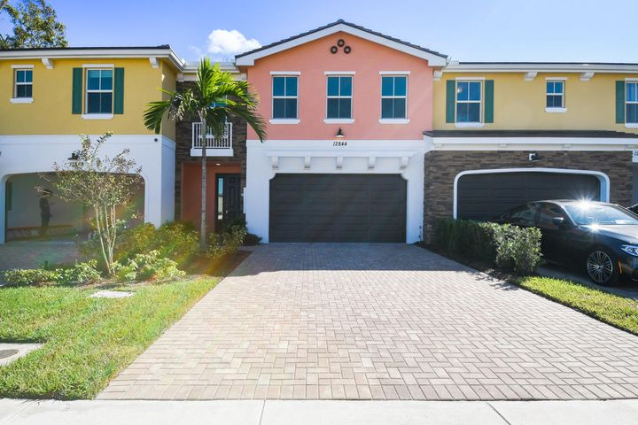 BRAND NEW TOWN HOME ..... NEVER LIVED IN!!!!!2 STORY- 2 CAR GARAGE, 3 BED/ 2.5 BTH- OPEN FLOOR PLAN IN GATED BOUTIQUE ENCLAVE OF ONLY 50 TOWNHOMES IN THE BEST PART OF PBG. 42'' upper wood cabinets, island kitchen with crown molding pkg, Granite counter tops, under mount cabinet lighting, Upgraded Porcelain floors on entire first floor, custom interior paint color throughout, Upgraded Stair Railing, wood/vinyl on stairs and upstairs hall and loft. Great Schools and literally you are located to miles to everything you do in your lifeThere is a community pool and walking paths for the residences of Trevi Isle. This is a Fantastic opportunity for the person looking for brand new construction and centrally located to everything AND a grade A school zone.
