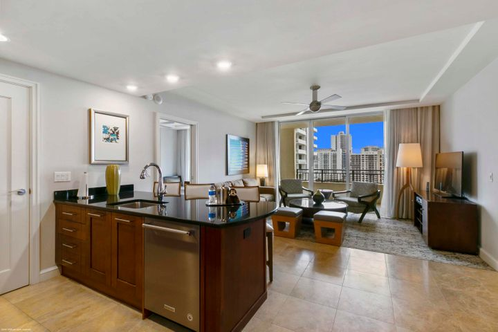 Don't miss this one! Rarely available 02 unit on a high floor offering dramatic views of the ocean, Singer Island and south to West Palm Beach from huge (44 foot long!), one of a kind terrace. You also get to enjoy the serenity of the waterfall below your terrace. Fully furnished 2 bedroom, 2 bath condo with large living room Coveted southeast exposure. Top-of-the line appliances, marble flooring, carpeting & granite counter-tops surrounded by world-class amenities. Wonderful family-friendly vacation retreat, relaxing and rejuvenating getaway or investment property on beautiful and unique Singer Island. Join the Marriott's rental program to generate income, rent on your own or move right in and live this luxury lifestyle yourself. Featuring 239 all-suite resort units and 66 residential condominiums, the resort includes 4,000 square feet of meeting space, an 8,500-square foot spa, and all of the amenities and services one would expect from a world-class facility.  Butler Service, valet attendants, and a full-time concierge will enrich guest experiences and activities, including coordination of private events, theater tickets, dinner reservations, and travel arrangements. Experience the essence of elegance in one or two bedroom resort units ranging from 800 square feet to just over 2,100 square feet of living space. Decorated with dark wood tones, stainless steel kitchen appliances, and marble baths, the resort offers a luxurious contemporary modern edge. Enjoy majestic views of the Atlantic Ocean or Intracoastal Waterways from the expansive terraces in each suite. Dining options include an alfresco ambiance at the ocean side eatery, the convenience of room service, or special events catered within the stunning entertainment veranda. Even a temperature-controlled wine room is available to store private wine collections. The white sands of Singer Island provide the ultimate place to relax. Attentive pool and beach side attendants provide everything from plush beach towels and relaxing lounge chairs to tempting frozen libations. Outdoor private cabanas are the ideal place to enjoy a casual poolside lunch.