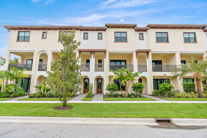This Beautiful and **like Brand New** 2019 ALTON 4 Bedroom 3 1/2 Bath, 2 Car Garage townhouse with Center island, Natural Gas appliances, huge master w/2 walk in closets.  The 1st floor suite can be used as a 4th Bedroom, Den or Office. Impact resistant windows & doors. 2 Patios with nice views & breezes. Hot Wire Cable & High Speed Internet included. Amazing clubhouse and resort style amenities: party room, huge fitness center, basketball, tennis, sand volleyball, pickle ball, huge pool & cabanas.  Short distance to all shops & numerous restaurants. Quick access to I-95 and the Turnpike.  Less than 13 minutes to Jupiter beaches & Gardens Mall. Excellent schools!