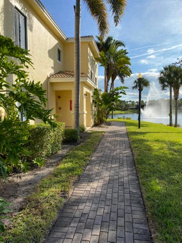 CONDO has new kitchen appliances, counters and sink.Freshly Painted thru out.  New floor tile and carpet and wood on stairs.  New Washer and Dryer.  Great location to the Gardens Mall and Downtown at the Gardens,  close to I-95 and 20 mins from PBI.  Clubhouse with pool and indoor racquetball. Come and enjoy living in this Condo.