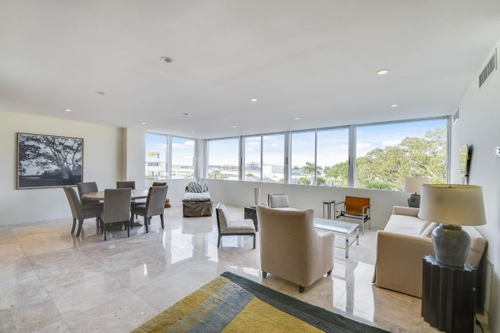 Wonderful 3 Bedroom/4 Bath unit in the Palm Beach Towers.  401A is a well-renovated, combined unit which is close to the elevator and convenient to all of the building amenities. This unit features great northern views famed by the massive Mysore fig tree with beautiful views of the Flagler Memorial Bridge and the Intracoastal beyond.  Cabana and 2 parking spaces included.