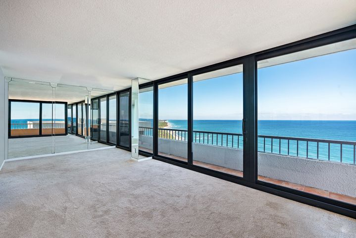 WOW! DIRECT OCEANFRONT CONDO with Unobstructed Panoramic Views Surrounded by Gorgeous Blue & Turquoise Waters Overlooking the Ocean to the East and John MacArthur Park just North with Incredible Water Views from Every Room! This direct east/southeast residence has floor to ceiling IMPACT GLASS windows and slider doors making it light and bright! Condo is ready to be designed with your own personal touch. Relax watching the boats cruise by while enjoying dining & drinks on your terrace with open views everywhere! This property possesses some of the best views on Singer Island! Property is easy to view, call today for your private showing! Water Glades residents have access to many amenities including private beach frontage, two heated pools, tennis courts, lush landscaped. See Supplement... recreation deck with an oceanfront owner's lounge with gorgeous views and plenty of space for entertaining. Each building has its own exercise room, library and extra storage. Water Glades is a 24-hour manned gated community just adjacent to MacArthur Beach State Park and nature preserve.  This building boats some of the best views on Singer Island!