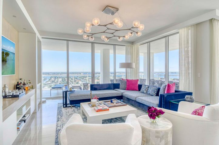 Take a look inside of this stunning new construction oceanfront condo with endless upgrades and breathtaking intracoastal and ocean views from the 16th floor. Features include floor to ceiling Impact glass, Italian Porcelain tile throughout, high end Miele appliances, and comes with its complete luxury decorator furnishings. With a very open floor plan, the views can be seen from all over the condo from the welcoming living room to the contemporary kitchen. The kitchen features soft-close cabinets and quartz countertops. The gorgeous master suite features sliders out to the patio, an upgraded tub and shower, and dual sinks. The outdoor living is unbeatable including a lap pool, an outdoor grill and bar area, a spa and beach access. The community of Vista Blue on Singer Island includes a state of the art Fitness Center and Yoga Studio and a community lounge with a private wine cellar.
