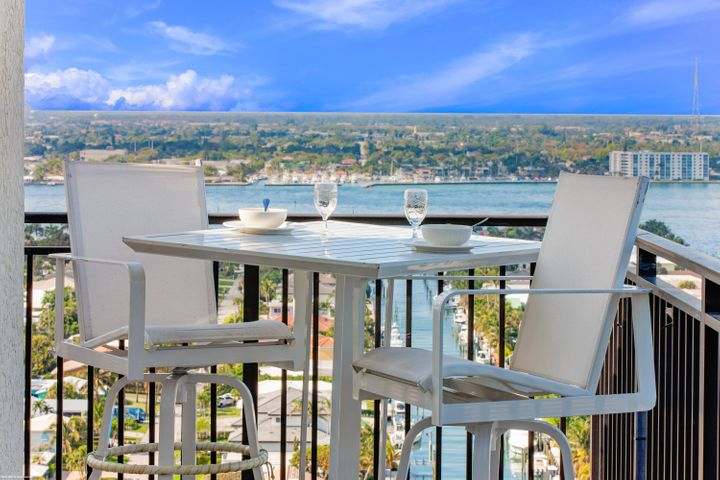 The best room in the house! Completely renovated 21st Floor  contemporary penthouse with expansive terrace in northwest corner of development with incredible ocean, Intracoastal & Singer Island views! 1,309 total of total sq. ft. including 504 Sq Ft wrap around balcony. Professionally decorated with porcelain tile flooring throughout. Living room has contemporary electric fireplace with stone accents. Kitchen has quartz counter tops & backsplash, spring pull-down faucet, recessed lighting, double wall ovens, cooktop stove, stainless steel appliances, custom cabinetry and breakfast bar with pendant lighting. This ''honeymoon suite'' is a top rental performer! 3D Walkthrough available (see virtual tour section of listing). Wonderful family-friendly vacation retreat, relaxing and rejuvenating getaway or investment property on beautiful and unique Singer Island. Join the Marriott's rental program to generate income, rent on your own or move right in and live this luxury lifestyle yourself.  Featuring 239 all-suite resort units and 66 residential condominiums, the resort includes 4,000 square feet of meeting space, an 8,500-square foot spa, and all of the amenities and services one would expect from a world-class facility.  Butler Service, valet attendants and a full-time concierge will enrich guest experiences and activities, including coordination of private events, theater tickets, dinner reservations, and travel arrangements. Experience the essence of elegance in one or two bedroom resort units ranging from 800 square feet to just over 2,100 square feet of living space. Decorated with dark wood tones, stainless steel kitchen appliances, and marble baths, the resort offers a luxurious contemporary modern edge. Enjoy majestic views of the Atlantic Ocean or Intracoastal Waterways from the expansive terraces in each suite. Dining options include an alfresco ambiance at the ocean side eatery, the convenience of room service, or special events catered within the stunning entertainment veranda. Even a temperature-controlled wine room is available to store private wine collections. The white sands of Singer Island provide the ultimate place to relax. Attentive pool and beachside attendants provide everything from plush beach towels and relaxing lounge chairs to tempting frozen libations.