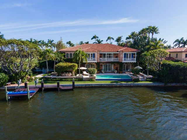 Exceptional waterfront estate with 5 bedrooms and 7 bathrooms. Foyer with grand staircase leads to waterfront living room with fireplace. Gorgeous formal dining room with wine room, fireplace, and butler's pantry. Gourmet eat-in kitchen with breakfast nook opens to family room. Beautiful library with wet bar and stunning fireplace doubles as a VIP guest suite with murphy bed. Expansive owner's wing with sitting room, dual walk-in closets and baths, and spectacular views of the Intracoastal and the Everglades Club Golf Course. Additional highlights include exercise room, 3 car garage, and impeccably maintained grounds. Fantastic outdoor spaces feature covered loggia, multiple covered balconies, infinity pool, dining loggia with summer kitchen, and boat dock. Located 5 blocks from Worth Ave.
