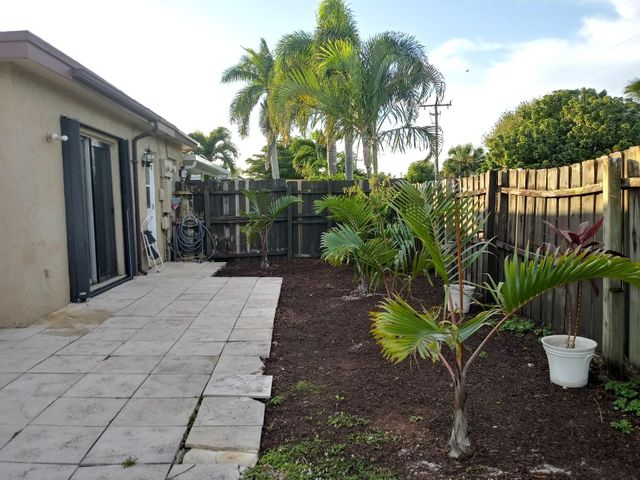 L:ook no more , this  3 bedroom 2 bath with huge back yard  in the center of town, move  in ready is waiting for you. Walking distance to major stores and restaurants. Tiled floors on living areas , carpet in bedrooms, freshly painted , neutral colors to match any  theme .Open living area and formal dining room. Washer and dryer inside the home. Huge fenced yard.