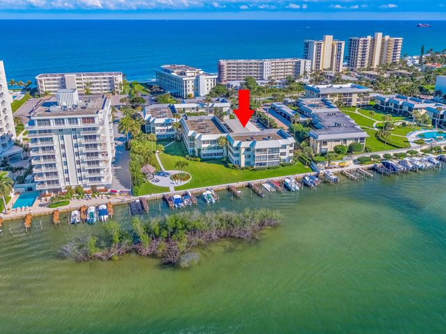 This beautiful condo is located on the south end of Jupiter Island on the gorgeous, turquoise Intracoastal waterways, directly across from the ocean with beach access. Featuring 2 bedrooms, 2 bathrooms, peaks of the Intracoastal, a private washer/dryer within the unit, updated bathrooms and oversized kitchen with stainless steel appliances. Home offers plantation shutters and wood floors throughout. One small pet welcome. This condo offers hurricane impact windows. Boat Slips Available through HOA. They are not deeded with the unit. Island House SW is a meticulously maintained building. Amenities include boat slips for up to a 26' boat. The dock is not deeded to the unit and is assigned through the association. Boat slips are currently available at no extra charge. Deeded walkway to the beach about 50 yards away, pool, elevator, car wash with softener, floating dock for swimming or launching water toys, kayak rack, bike rack, gas grills, beautifully manicured grounds, picnic and tiki area directly on the Intracoastal with views of the lighthouse, and full-time maintenance/supervisor on premise. This unit comes with 1 covered parking spot and storage unit. No pending special assessments. Conveniently located to great restaurants, shopping, golf, marinas, pristine beaches, and the Jupiter Inlet