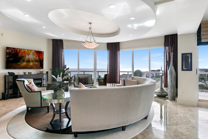 Experience the ultimate lifestyle!  Professionally furnished and finished with exquisite detail.  Warm and inviting with open kitchen, top of the line appliance pkg., beautiful bar area, separate dining area.Spacious master bedroom with ocean views and generous sized master bath. Second bedroom with built-in cabinets offer an ''office'' getaway and also a bedroom when needed. Stunning views of the Ocean and Intracoastal..Renown Ritz Carlton services include 24 hr. concierge, 24 hr.security, fitness center, library, theater room, social areas. Two pools, private grill restaurant, beach chair service - expect to be pampered. Come and enjoy the lifestyle - you won't want to leave.