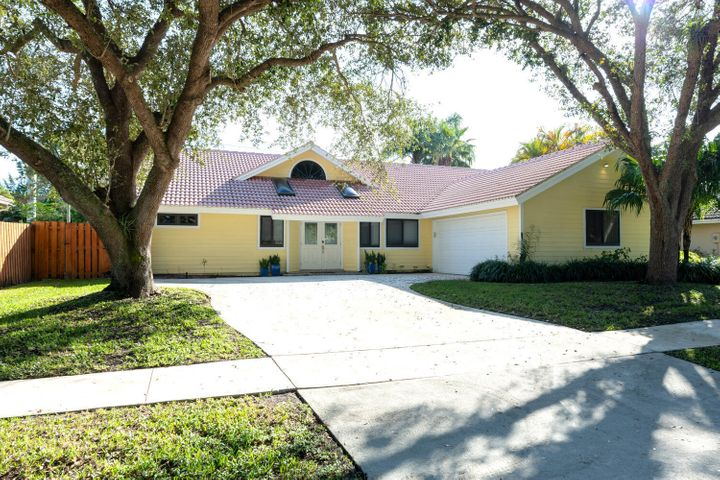 As you enter this 3/2 gem of a home in the Maplewood neighborhood in Jupiter, you immediately feel the natural light shining through the many skylights throughout the house. Both the A/C and windows have been replaced, along with many of the kitchen appliances.  The master bedroom has a huge walk-in closet with an extended area that is perfect for a home office.  Vaulted ceilings and the open floor plan make this a perfect family home.  The oversized screened in back patio is absolutely perfect for outside entertaining.  A nice sized privately fenced in and gated backyard leads to a walking trail. The beach, restaurants, shopping, entertainment and Abacoa's renowned public golf course are minutes away. Home is zone for wonderful Jupiter public schools.
