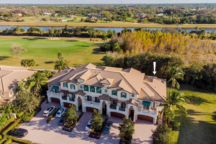This townhouse is a luxury corner unit carriage home located in Jupiter Country Club. This exceptional property backs up to a beautiful peaceful, private setting. Located on the second floor is a large master with a tray ceiling, crown molding, updated on-suite and a private balcony. Along with two guest bedrooms, another updated bath and a laundry room. All accessed by a luxury elevator or stairs. The main floor boasts a kitchen with upgraded cabinets, granite counter tops, and work desk. A dining area, living room and half bath round out the home. This is a must see in Jupiter Country Club!