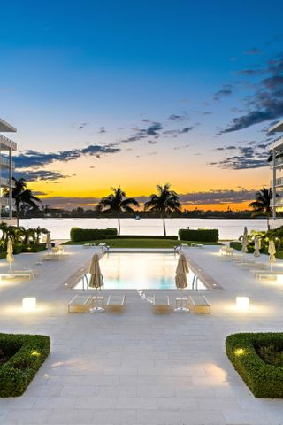 Create your Palm Beach oasis; this 2 BD/2BA residence has an expansive 43-ft terrace with stunning views of the Intracoastal and amazing sunsets. Spiral staircase on terrace leads directly down to the stunning Mario Navarro designed 75-ft pool. Both the spacious master bedroom suite and the guest bedroom have gorgeous water views and their own access to the spacious terrace. Located directly across the street from the exclusive Four Seasons Resort with beachfront dining, a world class restaurant, luxurious spa, and indoor & outdoor bars. The Cove is comprised of 3 buildings on 4 acres and boasts 425 feet of intracoastal frontage with a brand new seawall. Deeded beach access exclusively for Cove residents.