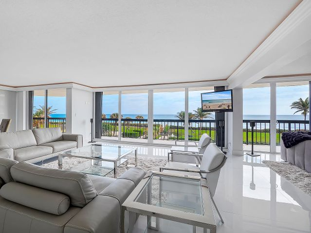 Panoramic sweeping views of the ocean from this gorgeous completely renovated 3 bedroom condo in Halcyon Palm Beach! Wrap-around 650 sq.ft. balcony offers breathtaking direct ocean views and Intracoastal views. NO EXPENSE SPARED -- Miele appliances, Swarovski crystal handles, quartz counters, designer light fixtures, oversized polished porcelain tile flooring, custom bathrooms, walk-in closets with built-ins and SO MUCH MORE. Halcyon has a beautiful salt-water pool and hot tub with new all new pool deck, gym/workout facility, garage parking, additional storage, clay tennis courts, on-site management and 24-hour security. The building has completely renovated the lobby and hallways and has a brand new roof!