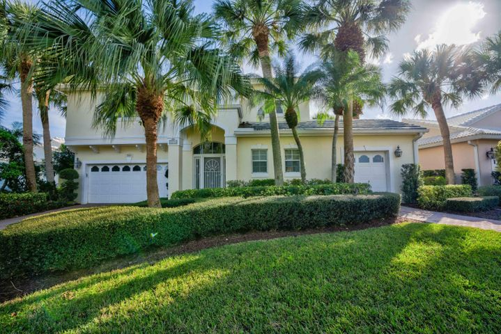 Expanded model with lake view. Huge open light ,bright kitchen/family room with pocket sliding doors to completely glassed in covered Florida room(glass is hurricane impact & screens available). Large high living room window and dining room windows are hurricane impact.   Water heater and a/c approximately 3 yrs old. Owner has an equity membership that is available.