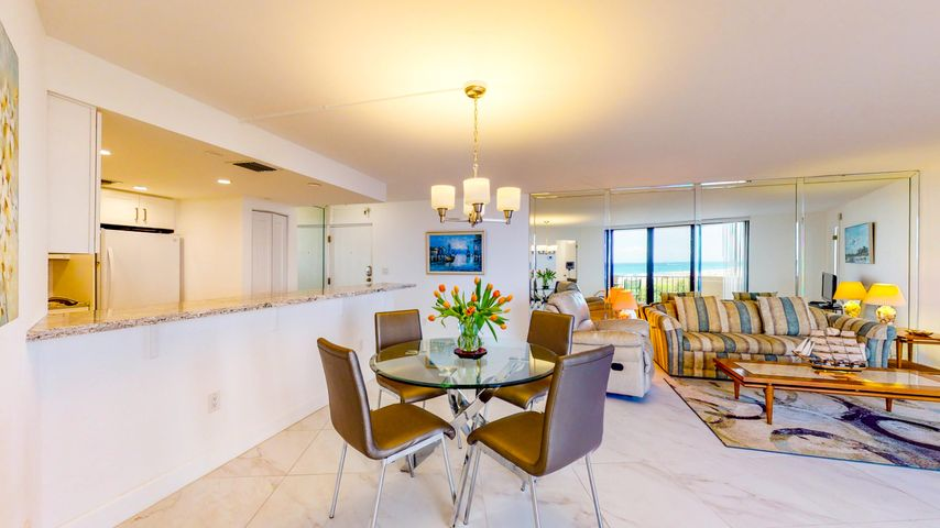 Beautifully remodeled condo with gorgeous ocean view and steps away from the wide Singer Island beach and within an easy walking distance to shops and restaurants Impact glass ungraded electric porcelain tile floors and Quartz counters in kitchen and baths will make this a beautiful and trouble free investment to use or rent Building allows 4 rentals a year which gives owners flexibility to use or rent when convenient covered parking space 178