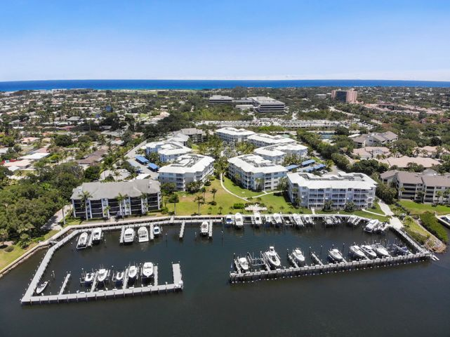 Spacious 2 bed, 2 full bath end unit only 4 years old.  Resort style living at Bay Colony on the Intra-Coastal w/ private marina - docks available. Dock owners may lease their condo unit and retain use of the dock.   Just a short bike or walk from the beach. Large open floor plan unit with high end kitchen appliances. Master has a large bathroom w/ 2 vanities, 2 closets Aa'' one a large walk-in.   Second bedroom has walk-in closet and full bath. Large utility room, high end washer & dryer, cabinetry & counter space.  Close to great shopping, dining, 15 minutes to the airport. Pool, spa, gym, clubhouse, tennis & pickleball, outdoor grills, kayak & paddle board racks, private marina. Air conditioned private storage in building.