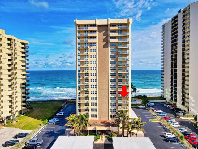 Enjoy the sunrise over the Atlantic Ocean while you sip your coffee and spectacular sunsets to the Intracoastal while you toast to a life well lived from your corner unit wrap around balcony.  This 2 bedroom 2 bathroom condo is an open canvas for it's new owner to create the seaside retreat of their dreams.  This condo has newer floors, all impact windows and doors (no shutters needed), brand new A/C unit and Water heater, and new dishwasher.  Aquarius is on the desirable and quiet north end of the Island with a newly renovated lobby and all the amenities from ocean-side pool, to fitness center and game room, to onsite manager and security.  Come see this unit while it lasts as it is priced to sell!