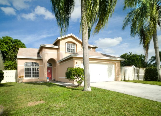 100 Heatherwood Drive, Royal Palm Beach, FL 33411
