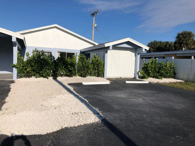 COME VIEW THIS UPDATED 2/2 1 CARPORT, RENTAL WITH PRIME P.G.A. LOCATION, NEW FANS, NEW VINYL PLANK FLOORS, LIGHTING, UPDATED BATHROOM, PAINT INSIDE OUT, UPDATED KITCHEN, CAR PORT, 2 PARKING SPOTS, PRIVATE YARD AREA, LAUNDROMAT NEARBY, EASY ACCESS TO SHOPPPING AND RESTAURANTS, I95 AND THE TURNPIKE.TRUCKS AND MOTORCYCLES AND PETS ALLOWED. CREDIT & BACKGROUND CHECK A MUST. EASY TO SEE CALL LISTING AGENT TODAY!