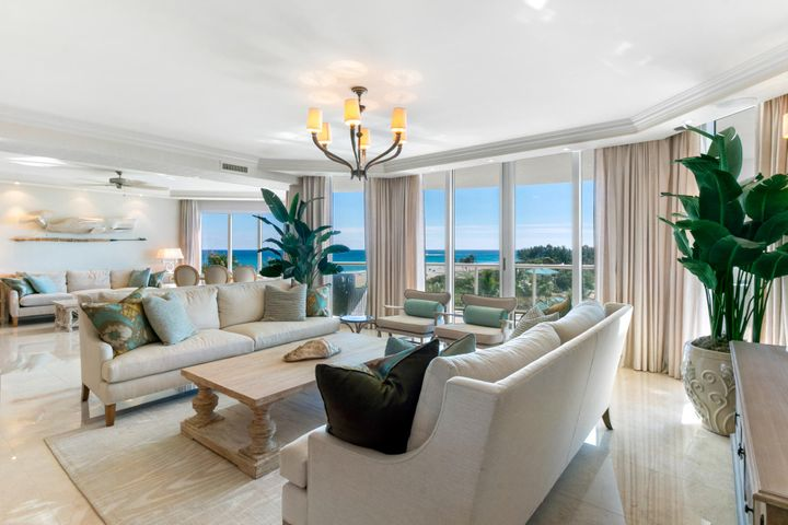 Escape to Coastal Living at its finest. Feel the elegance as you enter into this condominium professionally finished and decorated by SEEDS NY. Exceptional qualities throughout including a private elevator foyer entering into spacious livings areas with ocean views. A gourmet kitchen,separate master suite with ocean views and spa like bathroom with soaking tub and walk in shower. Ample master closet with extensive built ins await you.  Two additional bedrooms with en-suite baths plus a den/office that doubles as a 4th bedroom with separate closet.  Premier amenities include Valet parking, 24-hour concierge, social room with catering kitchen, cinema style media room and library. Two pools, private beach area and so much more.  It is all here, come and enjoy the lifestyle!