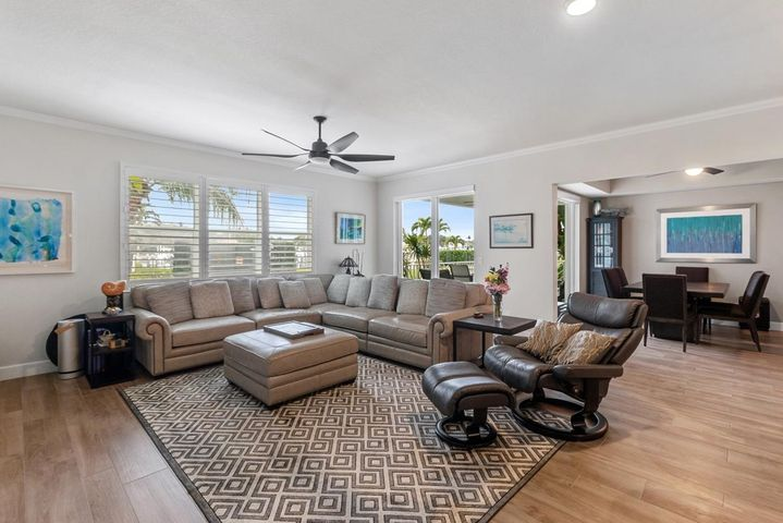A Boater's Dream!  RARE Waterfront, 1st floor condo, that can include a 40' X 16' Boat Slip with 20k lb. lift for boats up to 40 feet.  Fabulous Intracoastal views from this 2 BR + Den (den has full closet and can be converted back to a 3rd bedroom), 2.5 Baths condo with ample closet space complete with california closet organizers.  Open kitchen with dine-in bar seating, granite countertops, Upgraded Wolf Appliances  and Sub-Zero refrigerator, wood cabinets, soft-close drawers, and pantry with pullout drawers.  Lavish bathrooms with glass enclosures.  Porcelain tile throughout. A large Utility Room with front-end loaders, and an extra storage unit included.  Peace-of-mind living with impact glass, Smart Home system,  and secure video monitored building entry. entry to the building.  Resort-style clubhouse that includes heated pool and spa, Fire-pit, Bocce Court, Tennis courts, Pickle ball, stat-of-the-art fitness center, and a private marina for boats up to 40 Feet. Located close to the beach, airport, abundant shopping & fabulous restaurants.  This spacious condo is a must-see!