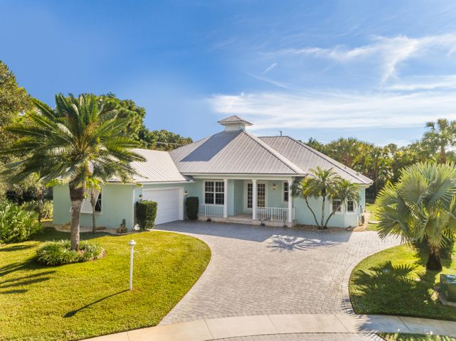 WOW !!! This 3 Bedroom plus den Key West style home will take your breath away. Impeccably maintained, super clean, light, bright and clutter free. This beauty features a metal roof, impact windows, high ceilings ranging from 9-13ft, a screened pool and deck area (redone in 2020) and a garage that you could eat off the floor from. There is a generous storage area above the garage. The property is situated on a half acre lot on a cul de sac with only 3 homes and is connected to public water. The river is literally across the street and Shopping, Restaurants and Schools are within a 5-10 min drive. This home is a true contender for anyone looking to purchase a quality home in the heart of Jupiter.