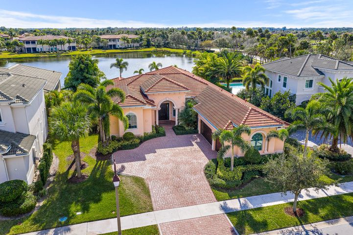 Are you searching for the perfect Jupiter Country Club home? Look no further than this beautiful Castania model. This is the most well appointed Castania model in the neighborhood and it is ready for a new owner. Upon entry you are greeted by an incredible great room overlooking the resort like pool, spa, and lake. The great room is a great spot for entertaining with a gracious bar and wine cooler. Walking through this home will you love the open space from the great room into the kitchen and living area. Love to cook? You are in for a treat with this gourmet kitchen fit for a professional chef. Gas cooktop, double stack oven, and incredible appliances mixed with ample counter and cabinet space ensure you are ready to cook whenever and however much you desire. Four bedrooms and four bathrooms provide ample space for your family or guests. A game room separating two guest bedrooms can accommodate anything you want. It can become a game room, theater, bar room, or second office. Another guest bedroom and bathroom accommodate this side of the home fit for a perfect guest with their own entrance to the pool deck. Moving to the other side of the home you will find a generous office space that will allow you to run your business from home. Entering the master wing you will be greeted by a light, bright, and airy master bedroom with a walkout to the pool deck. Expansive master closets for his and her and a bathroom fit for a king or queen you can ensure this home will fit all of you needs.