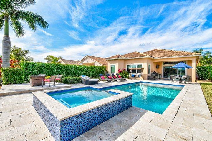 Rarely Available, One of the Largest Single Level Model Homes in Jupiter Country Club. This 3 Bed/2.5 Bath Pool Home has Exceptional Lake & Golf Course Views. Wide Open Floor Plan with Separate Den, Living & Dining Rooms. Modern Chefs Kitchen Includes; Fluted Cabinetry, Oversized Cooking Island, Granite Counter Tops, Top of the Line Appliances & Hooded Stove Top. Panoramic Windows & Doors Provide Tropical Pool/Spa, Lake & Golf Course Views. Covered Patio Lanai with a Summer Kitchen Plus an Oversized Fenced-In Backyard is Perfect for Entertaining. Outstanding Interior & Exterior Features Include's; Crown Molding, Coffered Ceilings & Window Treatments. Desirable 3 Car Garage. Fabulous Resort Country Club Amenities, Signature Greg Norman Golf Course, Minutes to the Beach, Downtown & Airport. ADDITIONAL PHOTOS WILL BE ADDED THIS 1/22 **RARE INTERMEDIATE GOLF MEMBERSHIP AVAILABLE WITH THIS HOME**Membership Required, Currently Purchaser has Option of Social Membership $5,000.00, Monthly Dues $350.00 Per + Tax, Intermediate Golf Membership $12,500.0, Monthly Dues $750.00 + Tax, or Full Golf Membership, $25,00.00, Monthly Dues $1,100.00 + Tax** *One Time Capital Contribution of 3 months HOA due at Closing*