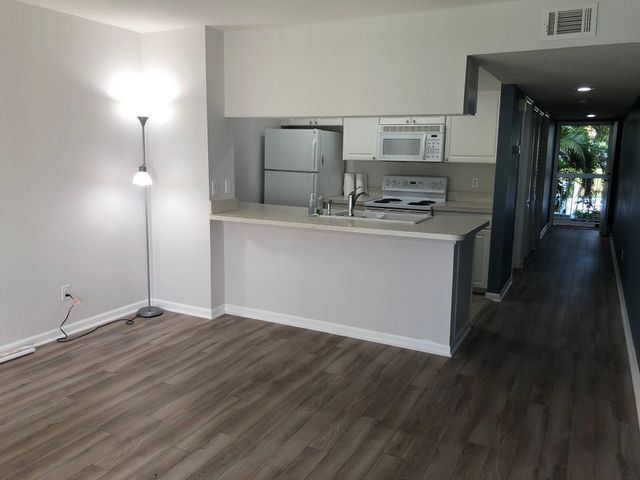 1/1 with water view, washer and dryer inside unit.Luxury laminate though out, No carpet!. LED lighting. Small pet permitted. Community pool close by and easy access to I95 and turnpike. Water/sewer/ Trash INCLUDED in rent. Landlord requires credit of 650 or greater and verifiable income of 3x rent.See below to applyhttps://apply.link/39RwIO8