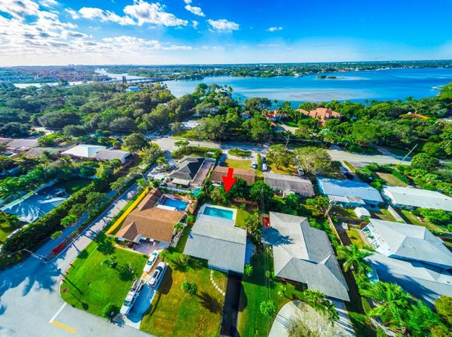 Location, Location, Location! A once in a lifetime opportunity to live in one of Jupiter's most desirable neighborhoods located just minutes away from the Jupiter Inlet Lighthouse and Museum. This lovely 3 bedroom 2 bathroom home features an oversized pool, lush landscaping complete with banana and avocado trees, and a fenced in backyard. Only a 5-minute drive to pristine beaches, fantastic local dining, and several shopping centers. Renovate your way and create your perfect home!