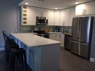 Newly remodeled kitchen with stainless appliances and soft-close doors. Tons of storage!
